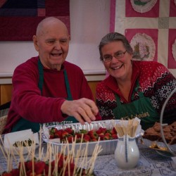 "Tony ""King Chocolate"" Bartley prepares strawberries to dip in his chocolate fountain with his daughter, Diane Bartley, one of the founders of the Moosehead Lake Region Chamber of Commerce Chocolate Festival, which will be held on Feb. 14 this year."