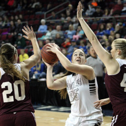 Houlton's Aspen Flewelling takes the ball to the basket from the low post Saturday afternoon as Foxcroft Academy's Abigail Simpson (40) and Kendra Ewer (20) converge. Houlton won the Class B quarterfinal 61-52.