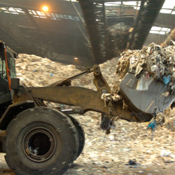 Refuse derived fuel made from municipal solid waste is moved toward the power generation system where it will be burned in a boiler to make electric power at Penobscot Energy Recovery Co. in Orrington in this September 2009 file photo.