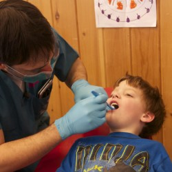 New York University student Jared Curtin brushes the teeth of patient Darion Wescott, 5, of Machias, at a dental clinic on April 14, 2015.