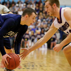 Portland High School's Liam Dinsmore faces off against Jake Black of Hampden Academy in the Class A state basketball championship game in Augusta in this February 2015 file photo.