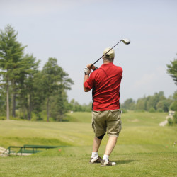 A golfer watches his drive on the 14th hole at Rocky Knoll Country Club in Orrington on July 29, 2009.