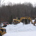 Volunteers help make, truck snow for biathlon world cup