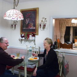 "Tom Picard (left) laughs with his wife, Tammy Shorey Picard, during dinner late Sunday evening at their home in Millinocket before Tom makes the trip to his apartment in Winslow to work in the Huhtamaki plant in Waterville for the week. He says he lives ""the new normal."" As a millworker, Tom has been laid off 10 times since 1980. Now, with home prices in the dumpster in his hometown of Millinocket, he can't sell his nearly paid off home for fair value, so he commutes to his new job 130 miles away, at the Huhtamaki plant in Waterville."