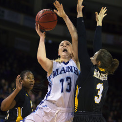 The University of Maine's Mikaela Gustafsson (center) drives hard for two past Maryland Baltimore County's Liz McNaughton (right) and Pandora Wilson during their game Jan. 9 at the Cross Insurance Center in Bangor.