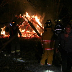 A small camp in Rockport was destroyed by fire Friday night. Rockport police and the state fire marshal are investigating.