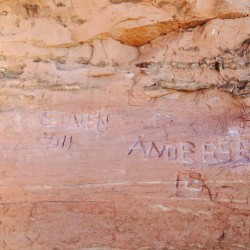 Graffiti is seen scratched into a sandstone wall near Frame Arch in Arches National Park near Moab, Utah, in this undated picture released by the National Park Service.