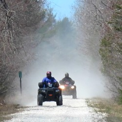 A pair of all-terrain vehicle riders head east Saturday morning on the Down East Sunrise Trail in Hancock. The western end of the 85-mile, multiuse trail, currently located at Washington Junction in the town of Hancock, will be extended this summer by 2 miles into central Ellsworth. Officials say the project should be completed some time this fall.