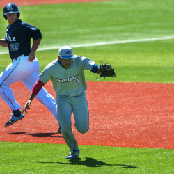 University of Maine's Brenden Geary (left) runs to third as University of Massachusetts Lowell's Oscar Marchena misjudges the ball during Saturday's game at Mahaney Diamond in Orono.