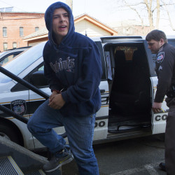 Colby Hodgdon exits the Belfast District Court on April 3, 2015, after making his initial appearance as a juvenile on a charge of murder in the death of his father, Steven Hodgdon of Troy.