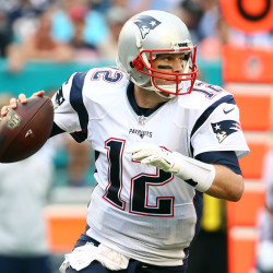 New England Patriots quarterback Tom Brady (12) scrambles during the second half against the Miami Dolphins at Sun Life Stadium on Jan. 3.