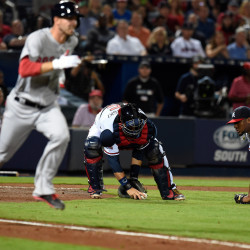 Atlanta catcher A.J. Pierzynski is unable to field a bunt by Boston's Rick Porcello during the seventh inning Monday night at Turner Field in Atlanta. The Red Sox defeated the Braves 1-0.