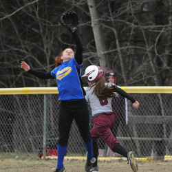 Ellsworth High School's Leah Stevens gets to first base safely during a game against Hermon High School last year.