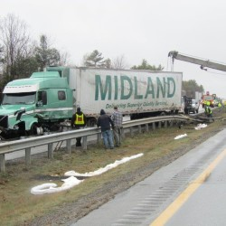 A tractor-trailer crash on Interstate 95 in Farmingdale slowed northbound and southbound traffic Monday morning as crews worked to clear the scene.