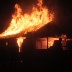 "The Camden Fire Department set fire Sunday night to a house on Thomas Street for a scene in the movie ""Island Zero."""