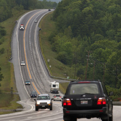 Traffic travels on Route 1A in Dedham near Lily Road on Aug. 6, 2014.