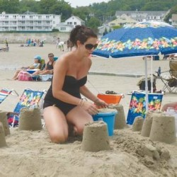 A builder stands at top Murphy's Castle, one of nearly 50 entries in the Ogunquit Parks and Recreation Sand Castle Contest in this 2014 file photo.