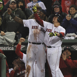 Boston Red Sox first baseman Hanley Ramirez (left) reacts with catcher Christian Vazquez (right) after Vazquez hit a two-run home run during the seventh inning against the New York Yankees Sunday night at Fenway Park in Boston.