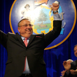 Gov. Paul LePage (left) takes the stage and celebrates during his second inaugural while Speaker of the House Mark Eves applauds in Augusta in this January 2015 file photo.