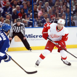 Detroit Red Wings center Gustav Nyquist (right) skates with the puck as Tampa Bay Lightning right wing Ryan Callahan defends during the second period of the game two of the first round of the 2016 Stanley Cup Playoffs on April 15 at Amalie Arena in Tampa, Florida.