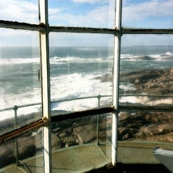 "The rugged coast line of Mistake Island can be seen from inside Moose Peak Light. The island and neighboring fishing village of Jonesport were the settings for the movie, ""To Keep the Light,"" filmed on location in the summer of 2014."