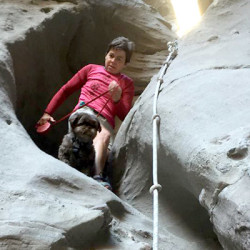 Gizmo and Lori Allen descend a canyon in California.
