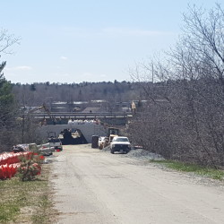 Maine Department of Transportation crews work on a bridge that carries Interstate 395 over Webster Avenue in Bangor. Signs posted around I-395 announce the road will be closed May 6-10 to complete the replacement of the bridge.