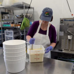 Sarah Wilder and her husband, Ryan Cowan, started their own small batch ice cream business called Wild Cow Creamery in 2013.  Getting ready to make a blueberry crumble ice cream, Sarah mixes up a base in her ice cream kitchen.