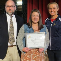 John Bapst Memorial High School's Abigail Bowman (center) received the Julia Clukey Courage Award Monday from Olympian Julia Clukey (right). John Bapst principal David Armistead (left) was also on hand for the presentation.