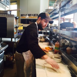 Kyle Kunesh works the line at the Somerset Tap House. He has been working nonstop since the restaurant opened at Whole Foods Market, where a line cook has been advertised for a month.