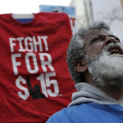 A demonstrator reacts during a protest for a $15-an-hour nationwide minimum wage in downtown Chicago in April.