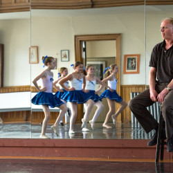 Keith Robinson (right) watches one of his ballet classes work through a routine at Robinson Ballet in Bangor on Monday afternoon.