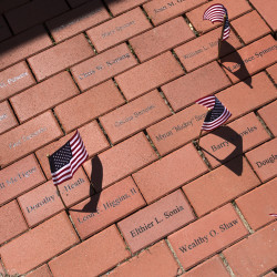 A short walkway at the Bangor International Airport that bears the names of troop greeters who have died since 2003 can be seen Wednesday in Bangor.