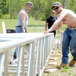 Stage riggers Louis DeSousa (far left) and Mike Cusimano (black shirt) watch as workers adjust scaffolding at Matrix Pavilion at Mount Jefferson Resort in Lee.