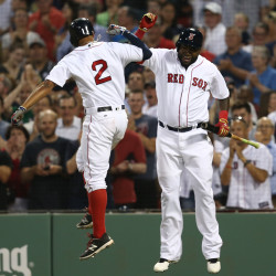 Boston's Xander Bogaerts (left) celebrates his home run against the Colorado Rockies with designated hitter David Ortiz during the fourth inning at Fenway Park in Boston on Wednesday night.