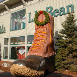 — A Christmas wreath adorns the large-than-life-sized L.L. Bean boot set beside the rear entrance to the retailer's flagship store on Main Street in Freeport.
