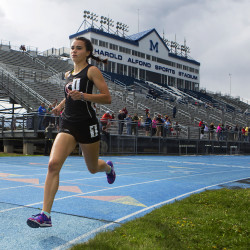 Orono High School's Tia Tardy starts her second lap of the 1600-meter run during a track meet at the University of Maine in Orono.