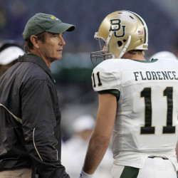 Baylor Bears head coach Art Briles (left) talks with quarterback Nick Florence on the field against the Texas Tech Red Raiders during the game at Cowboys Stadium in Arlington, Texas, in this November 2012 file photo.