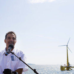 Habib Dagher, director of University of Maine advanced structures and composites sector, speaks to the crowd during a trip to celebrate the first year of the University of Maine's floating wind turbine, VolturnUS, in Castine, Sept. 5, 2014.