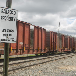 A posted sign warns pedestrians not to cross railroad tracks in Fort Kent, May 17.