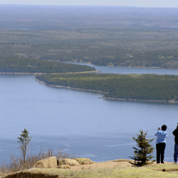 Visitors to Acadia National Park take in the sights from Cadillac Mountain on May 18.
