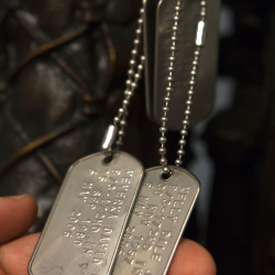 Former 172nd Mountain Infantry commander Lt. Col. Darryl Lyon, who held the rank of captain of the Brewer unit in 2006 when deployed to Iraq, holds the dog tags of Staff Sgt. Dale Kelly and Staff Sgt. David Veverka, who were killed in the line of duty over a decade ago under his command.