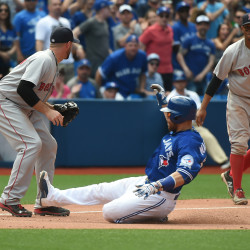 Toronto Blue Jays catcher Russell Martin (55) slides safely into third base between Boston Red Sox third baseman Travis Shaw (47) and shortstop Xander Bogaerts (2) in the eighth inning Saturday at Rogers Centre in Toronto. The Jays won 10-9.