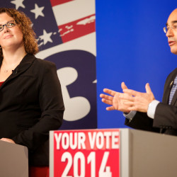 Democrat Emily Cain (left) listens as Republican Bruce Poliquin makes a comment about her during the 2nd Congressional District debate on Oct. 14, 2014, at the CBS 13 television studios in Portland.