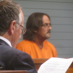 Randall Junior Weddle, 54, of Greeneville, Tennessee made his initial appearance in a Maine court on two counts of manslaughter and two counts of aggravated operating under the influence. His attorney, David Paris, sits reading the court documents prior to the hearing, May 16, 2016.