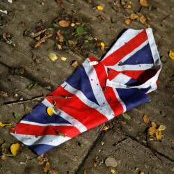 A British flag which was washed away by heavy rains the day before lies on the street in London, Britain, June 24, 2016, after Britain voted to leave the European Union in the EU BREXIT referendum.