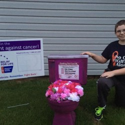 "Cancer survivor Wendell Boyd, 10, of Mars Hill poses recently with his purple ""Flush Out Cancer"" toilet, which he has used to raise awareness and money for the Maine chapter of the American Cancer Society."