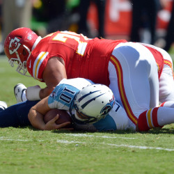 Tennessee Titans quarterback Jake Locker (left) is sacked by Kansas City Chiefs defensive end Mike DeVito (center) and outside linebacker Justin Houston during the first half at Arrowhead Stadium in Kansas City, Missouri, in this September 2014 file photo.
