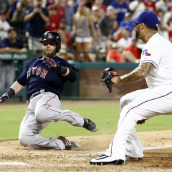 Boston's Dustin Pedroia (left) slides home for the game-winning run on a wild pitch thrown by Texas Rangers relief pitcher Matt Bush (right) during Friday's game at Globe Life Park in Arlington, Texas. The Red Sox scored four times in the ninth to win 8-7.