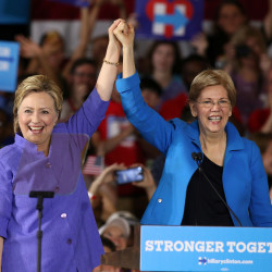 Democratic presidential candidate Hillary Clinton (left) stands along side U.S. Sen. Elizabeth Warren at a campaign rally in Cincinnati, Ohio, June 27, 2016.